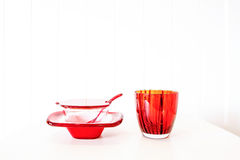 White and red ceramic and glass bowl. On white background Royalty Free Stock Images