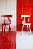 White / red chair. On tile background Stock Photography