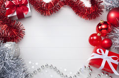 White & Red Christmas Background. A Christmas background with a red and white theme. With presents, decorations and tinsel. Please see my extensive range of stock photos