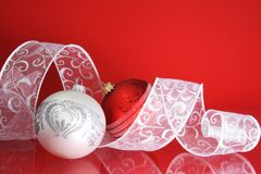 White and Red Christmas Balls with Ribbon. Blank Space for Text Royalty Free Stock Photography