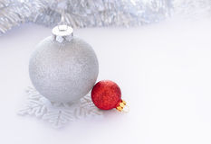 White and Red Christmas Balls on the White Background whith Space for Text Royalty Free Stock Photos