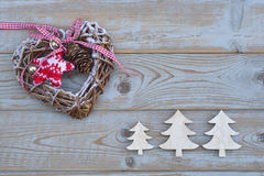 White red christmas decoration as christmas tree, reindeer and star on a old grey wooden planks background with empty copy space Stock Photos