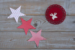White red christmas decoration as christmas tree, reindeer and star on a old grey wooden planks background with empty copy space Royalty Free Stock Photography