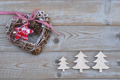White red christmas decoration as christmas tree, reindeer and star on a old grey wooden planks background with empty copy space Stock Images