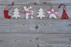 White red christmas decoration as christmas tree, reindeer and star on a old grey wooden planks background with empty copy space Royalty Free Stock Images