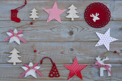 White red christmas decoration as christmas tree, reindeer and star on a old grey wooden planks background with empty copy space. White red christmas decoration Stock Image