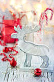 White and red christmas decoration with deer, greeting card. Vintage winter holidays decoration on white background Stock Photos