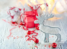 White and red christmas decoration with reindeer, greeting card. Vintage winter holidays decoration on white background Royalty Free Stock Image