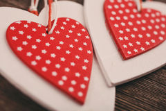 White and red christmas hearts on wooden background,  for greetings Valentine`s  day Stock Photo