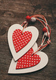 White and red christmas hearts on wooden background,  for greetings Valentine`s  day Stock Photography