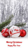 White and Red Christmas ornaments and fir tree branch on glitter bokeh background with space for text. Xmas and Happy New Year. Theme Stock Images