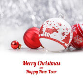 White and Red Christmas ornaments on glitter bokeh background with space for text. Xmas and Happy New Year card. White and Red Christmas ornaments on glitter stock photos