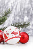 White and Red Christmas ornaments on glitter bokeh background with space for text. Xmas and Happy New Year. Theme Royalty Free Stock Photo