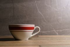 White and red coffee cup on the table stock photography