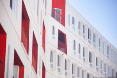 White and Red Concrete Building Under Blue Sky during Daytime Royalty Free Stock Photography