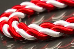 White and red cord. With dark background stock image