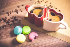 White and Red Couple Heart Mug Filled With Coffee And Macaroons Stock Image