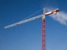 White and red crane gibbet on blue sky Stock Photo