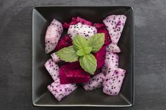 White and Red Dragon Fruit Salad in a Ceramic Bowl Stock Photos