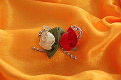White and red fabric roses on satin like textile background Stock Photos