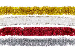 White, red, golden, silver Christmas tinsels isolated Royalty Free Stock Images