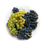 White and red grapes plate Royalty Free Stock Images