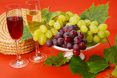 White and red grapes and wine Royalty Free Stock Photo