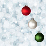 White, Red  Green Christmas Ornaments Silver Bokeh. White, Red and Green Christmas Ornaments On Silver Bokeh Background Royalty Free Stock Image