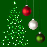 White, Red, Green Christmas Ornaments & Tree. White, Red and Green Christmas Ornaments On Green Christmas Tree Background Stock Photo