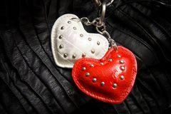 White and red heart on a chain Royalty Free Stock Photography