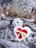 White heart with red detail on cozy knitted background stock photography
