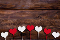 White and red heart on a stick. On a wooden background Stock Images