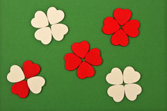 White and red hearts. On green background Stock Image