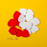 White and red hearts. On yellow background Stock Photos