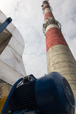 White and red high concrete chimney Stock Images