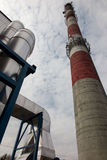 White and red high concrete chimney Royalty Free Stock Photos
