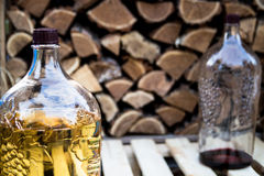 White and red homemade wine. In huge bottles Stock Image
