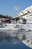 White & red house mirroring in the Hvalfjord Stock Photography