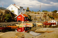 White and red house near fjord Kragero, Portor Royalty Free Stock Photo