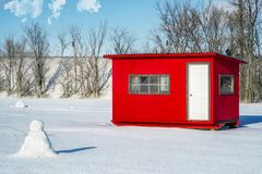 White and Red Ice Fishing Cabin in Ste-Rose. Ice Fishing cabins in a vast spaces on the frozen Rivière des Mille Îles in Ste-Rose, Laval, Quebec, Canada Stock Photography