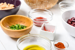 White And Red Kidney Beans, Chili Pepper, Paprika, Parsley, Olive Oil and Ketchup Food Ingredients Stock Photo