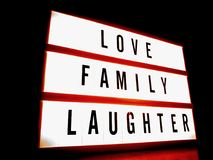 White and Red Led Signage With Love Family Laughter Text royalty free stock image