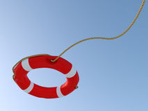 White and red lifebuoy thrown in the air. Stock Image