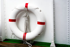 White red Lifebuoy and white ship. With wooden deck Stock Images
