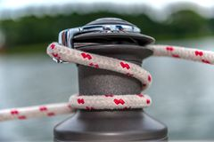 White and red line on capstan. Sailboat Winch and Rope Yacht detail. Yachting Royalty Free Stock Images