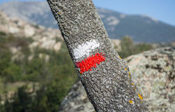 White and red marks of a Long Distance Walking Route Royalty Free Stock Photos