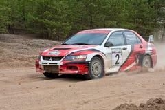 White and red Mitsubishi Lancer Stock Image