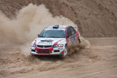 White and red Mitsubishi Lancer on rally Royalty Free Stock Photography