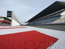 White Red Painted Concrete Pavement on Racetrack Stock Photos