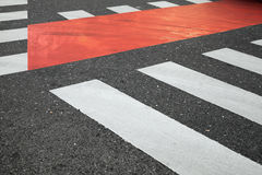 White and red pedestrian crossing road marking Stock Image